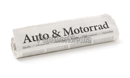 newspaper roll with the headline car