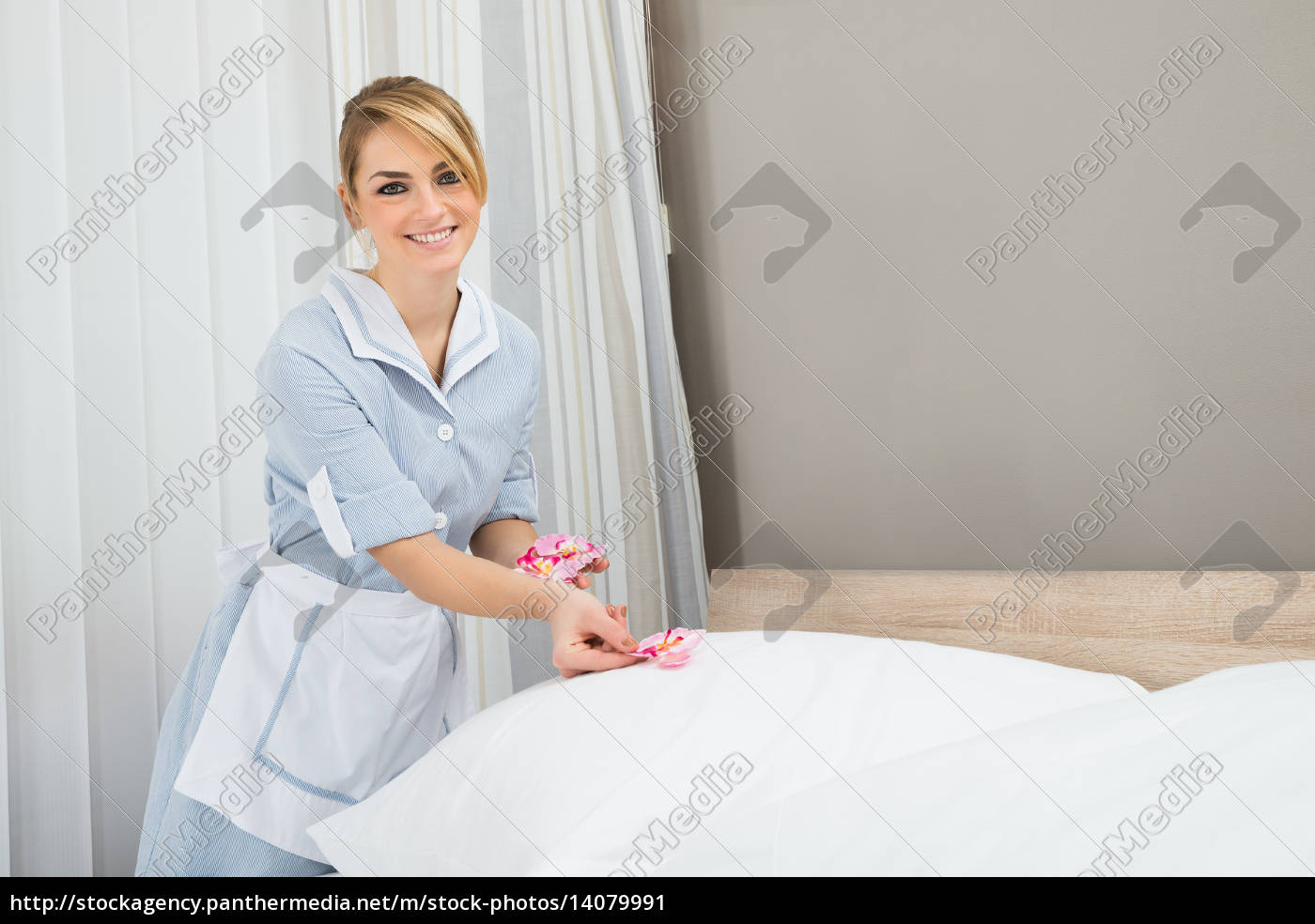 housekeeper, decorating, bed, with, petals - 14079991