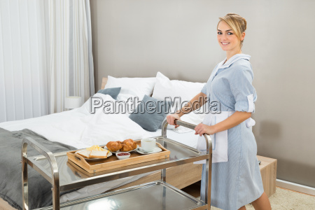 woman, pushing, trolley, with, breakfast - 14079955
