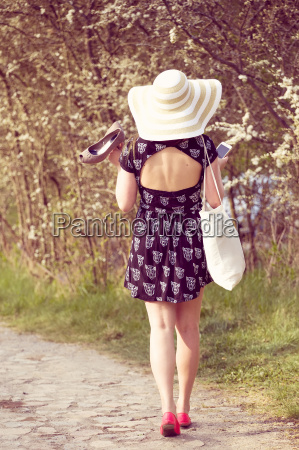 back view of cheerful fashionable woman