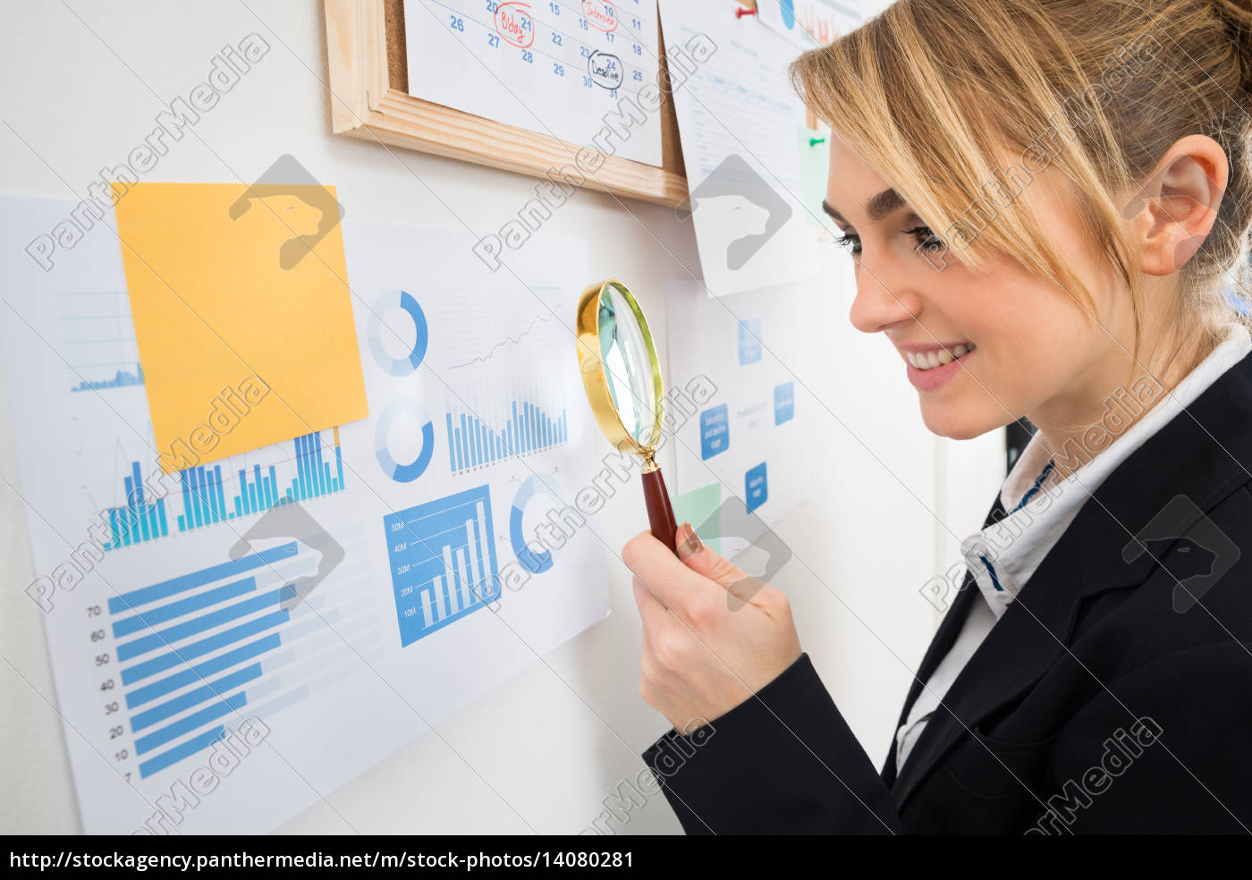 businesswoman, examining, graph, with, magnifying, glass - 14080281