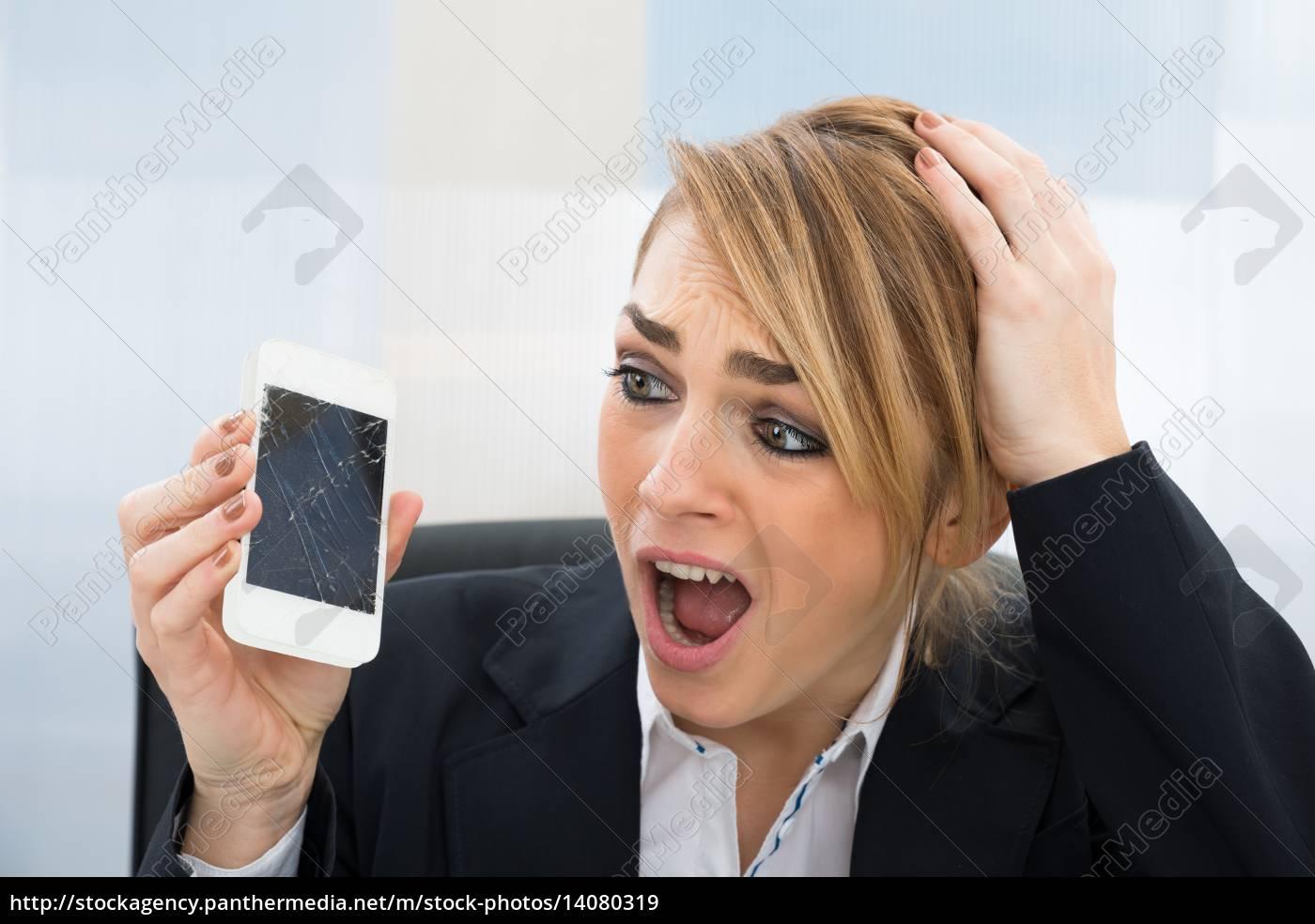 businesswoman, holding, broken, smartphone - 14080319