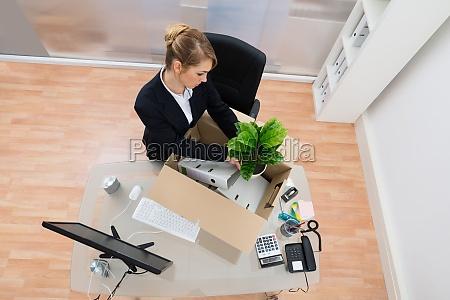 businesswoman, packing, belongings, in, office - 14080267