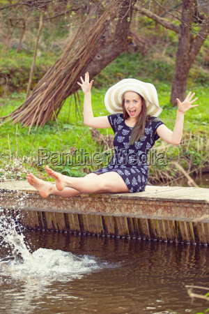 cheerful, fashionable, woman, sits, on, small - 14080719
