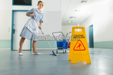 janitor, with, mop, and, wet, floor - 14080073