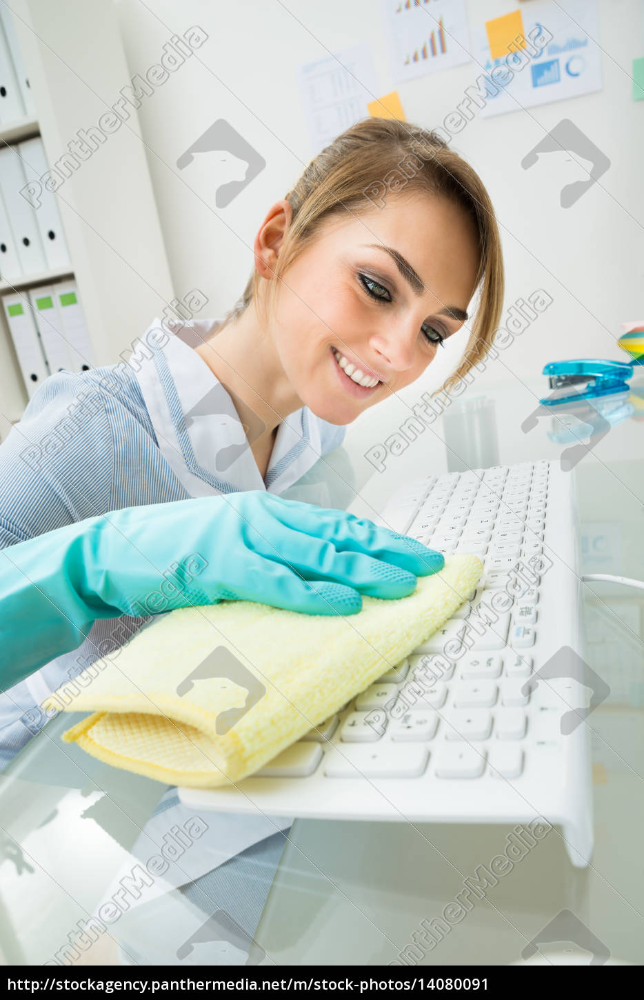 maid, cleaning, keyboard, at, desk - 14080091