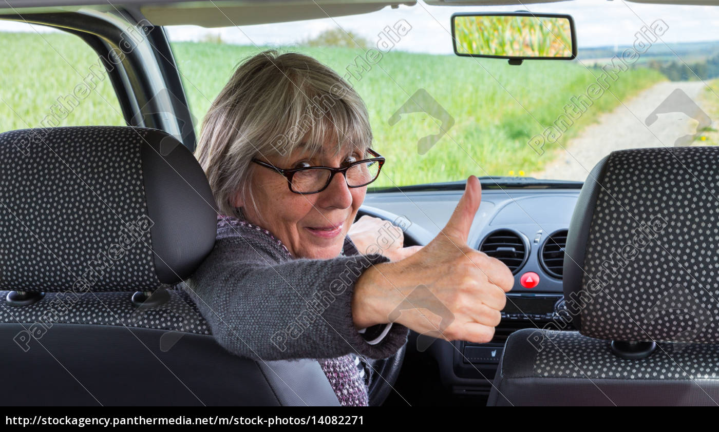 senior, in, a, car, with, thumbs - 14082271