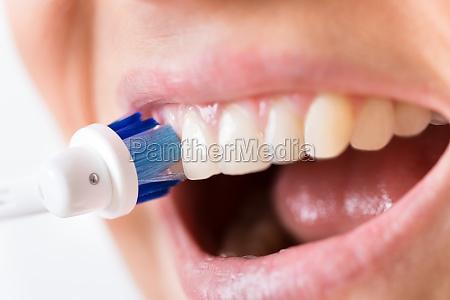 person brushing teeth