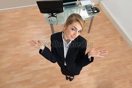 businesswoman, shrugging, in, office - 14083529