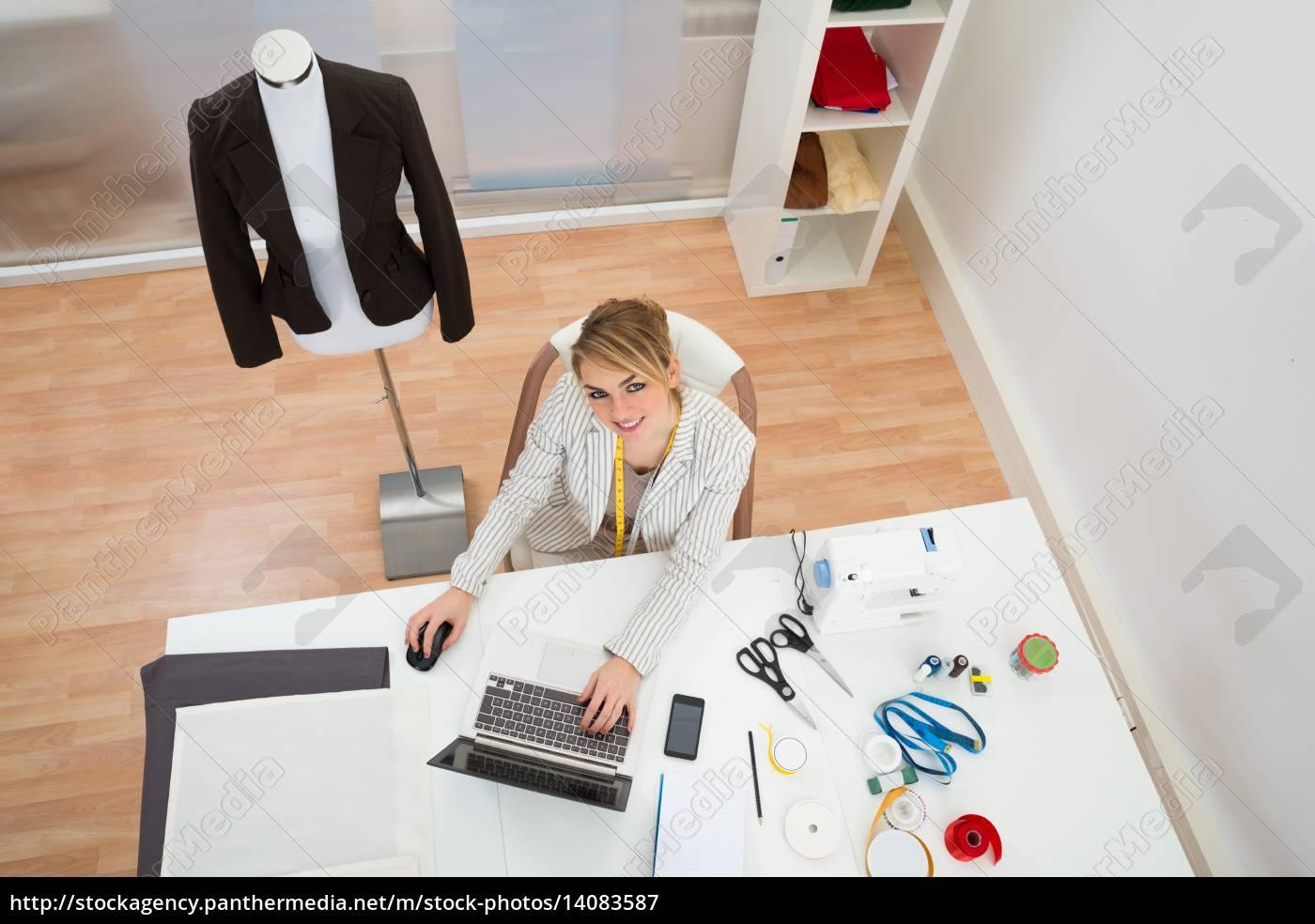 fashion, designer, using, laptop - 14083587