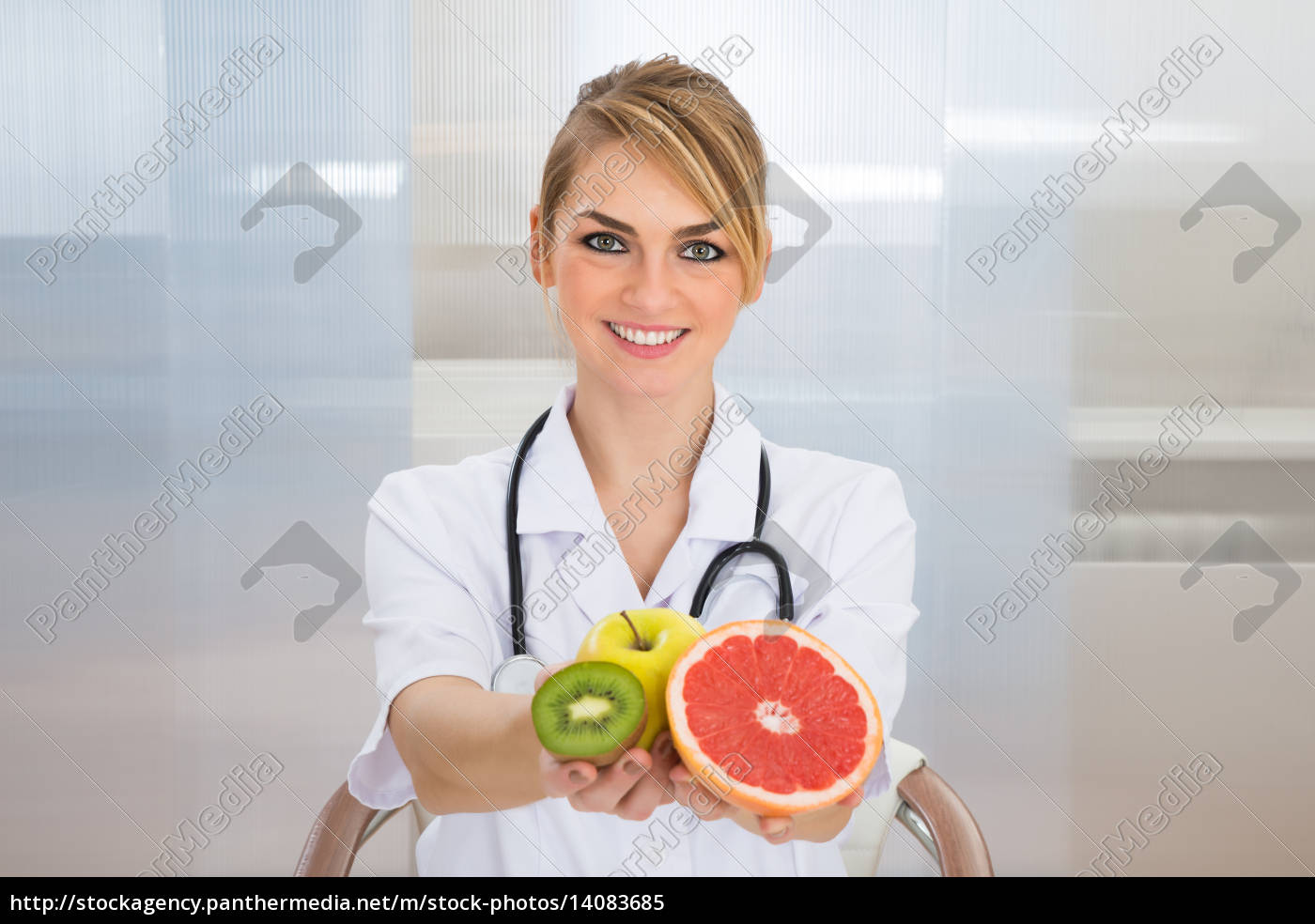 female, dietician, holding, fruits - 14083685