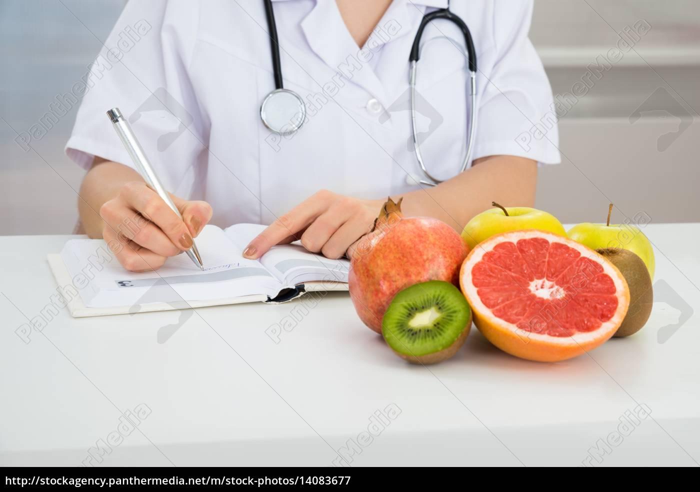 female, dietician, writing, prescription - 14083677