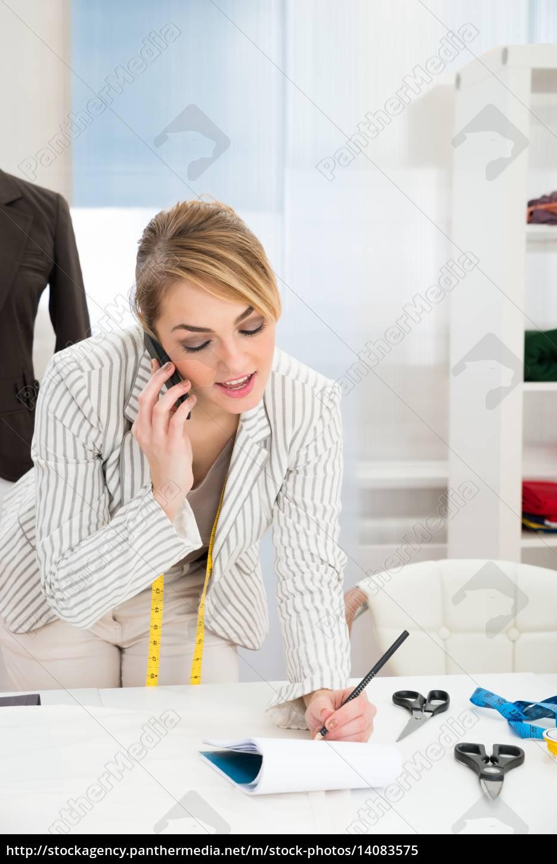 female, fashion, designer, talking, on, cellphone - 14083575