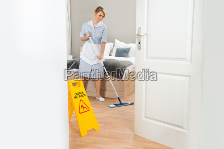 maid, cleaning, floor, with, mop - 14083499