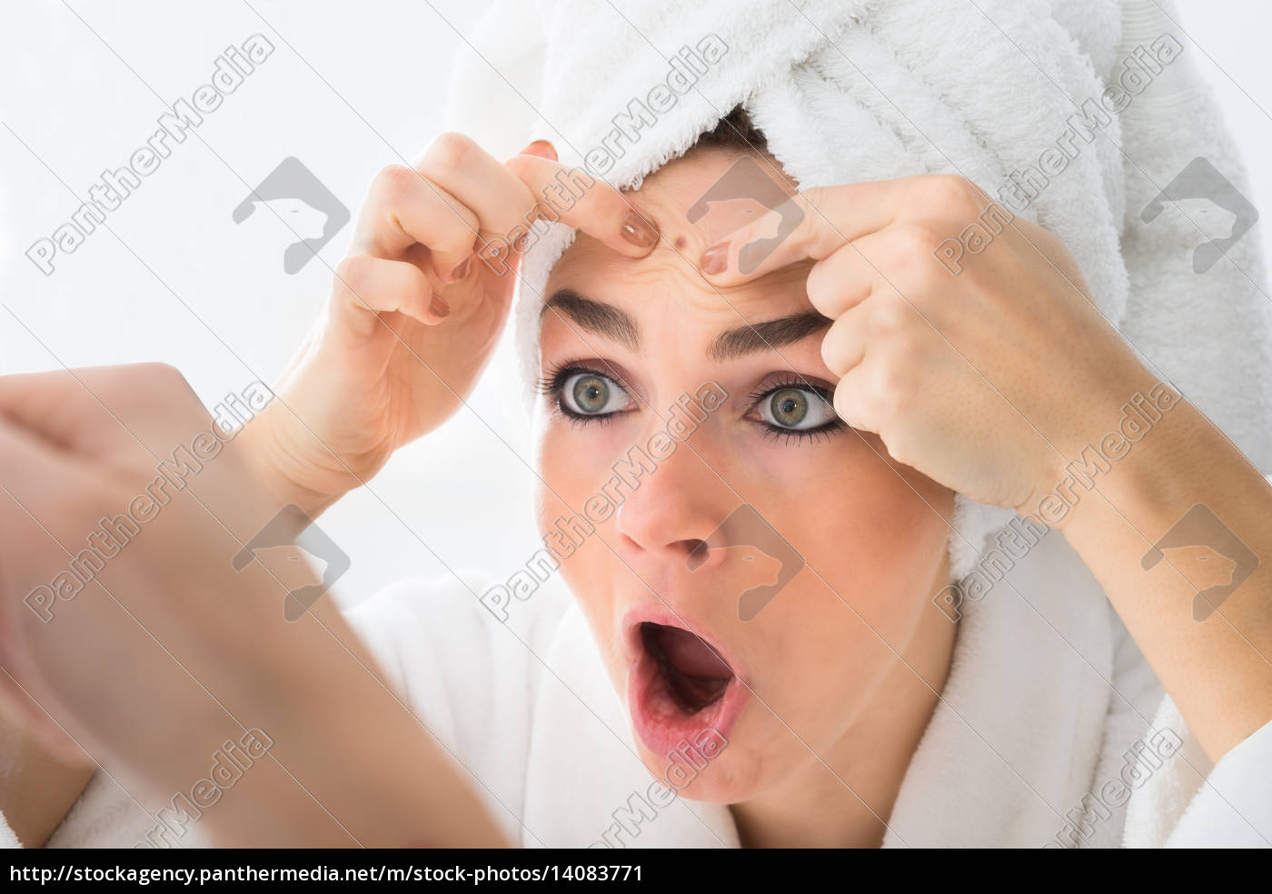 shocked, woman, looking, at, pimple, on - 14083771