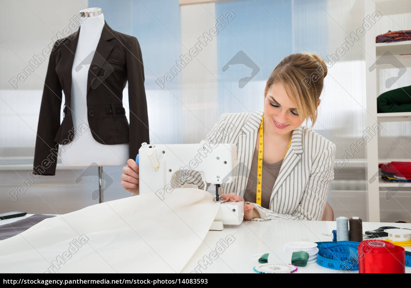 woman, working, on, sewing, machine - 14083593