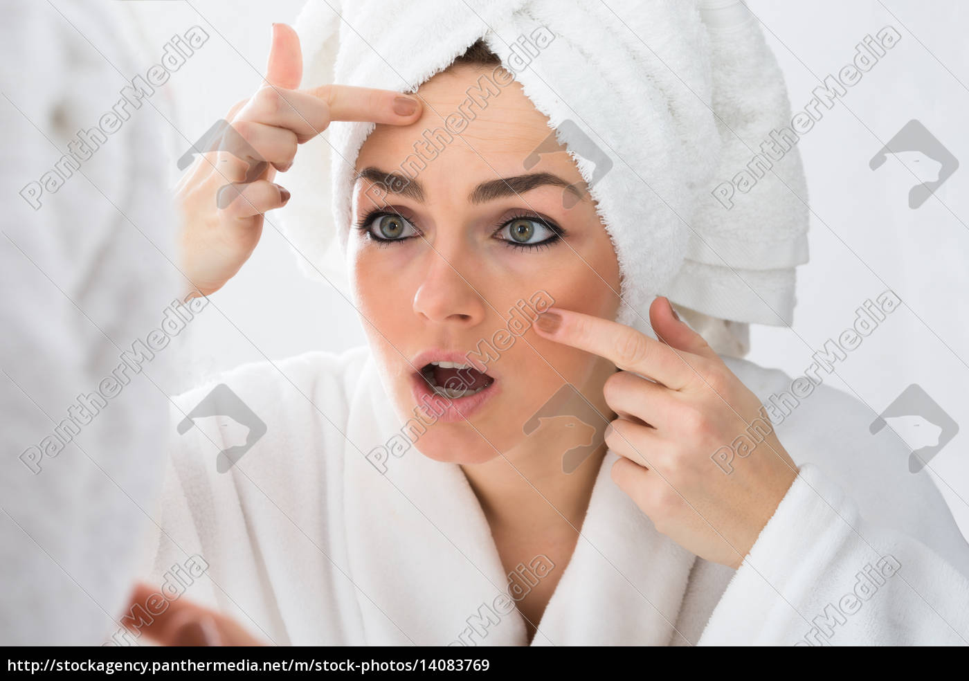 worried, woman, looking, at, pimple, on - 14083769