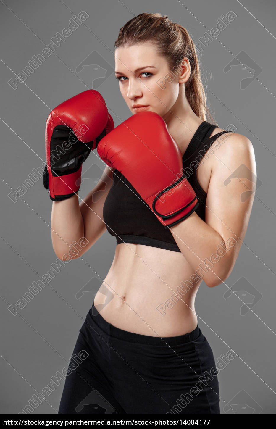 beautiful, woman, is, boxing, on, gray - 14084177