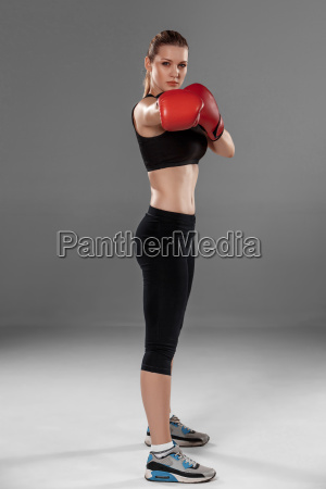 beautiful, woman, is, boxing, on, gray - 14084185
