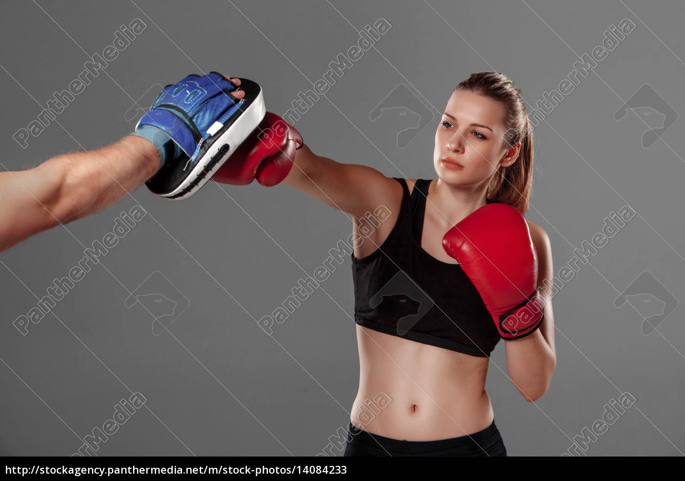 beautiful, woman, is, boxing, on, gray - 14084233