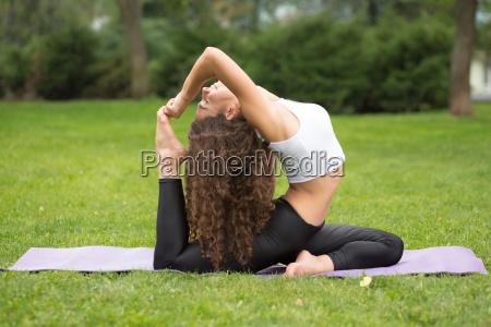 pretty, woman, doing, yoga, exercises - 14084131