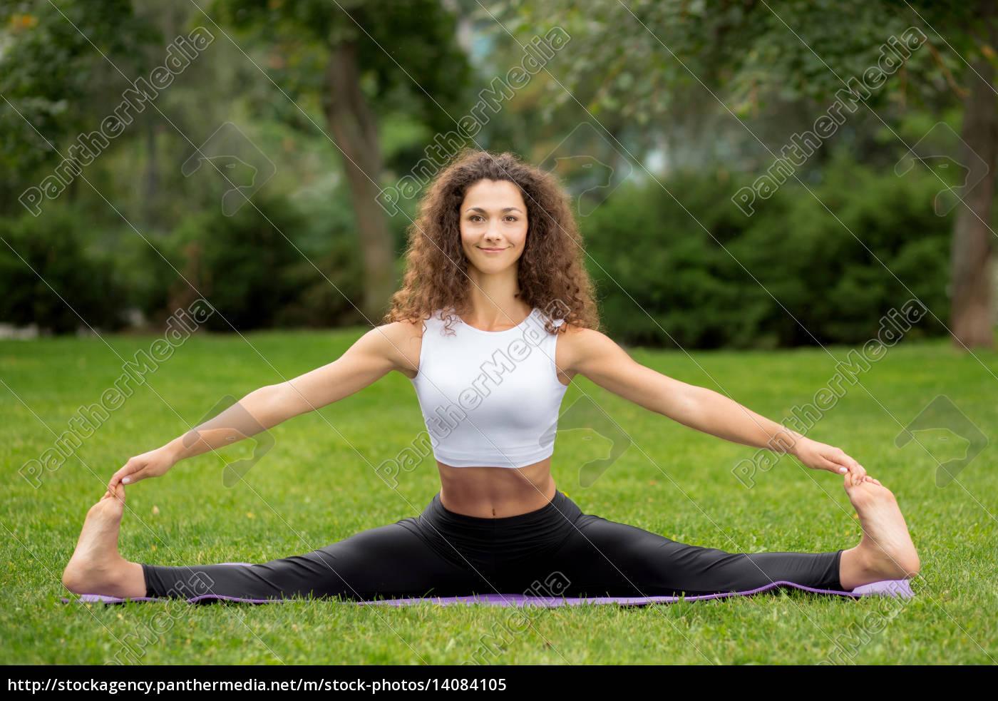smiling, pretty, woman, doing, yoga, exercises - 14084105