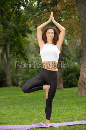 smiling, pretty, woman, doing, yoga, exercises - 14084175