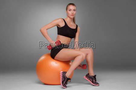 sporty, woman, doing, aerobic, exercise - 14084067