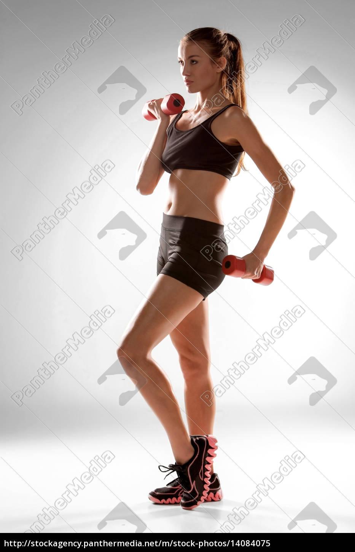 sporty, woman, doing, aerobic, exercise - 14084075