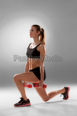 sporty, woman, doing, aerobic, exercise - 14084089