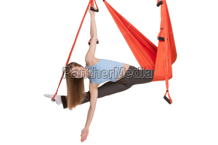 young, woman, doing, anti-gravity, aerial, yoga - 14084029