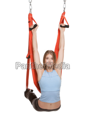 young, woman, doing, anti-gravity, aerial, yoga - 14084069