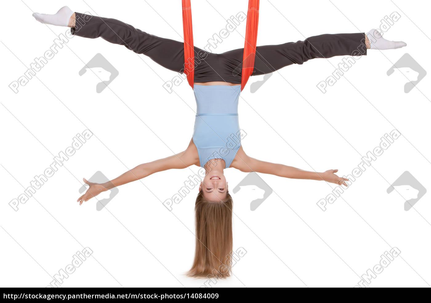 young, woman, making, antigravity, yoga, exercises - 14084009