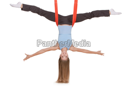 young, woman, making, antigravity, yoga, exercises - 14084009