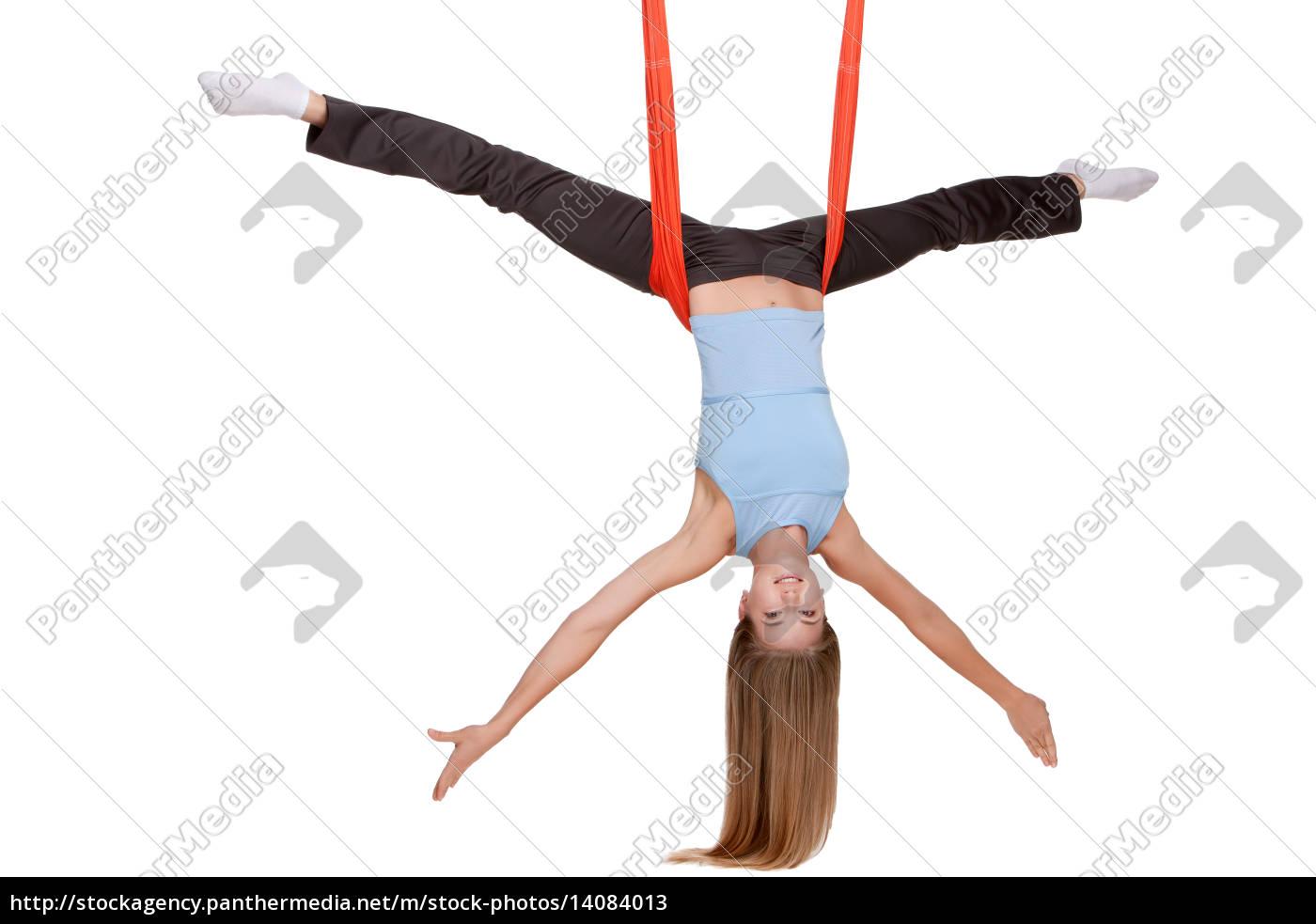 young, woman, making, antigravity, yoga, exercises - 14084013