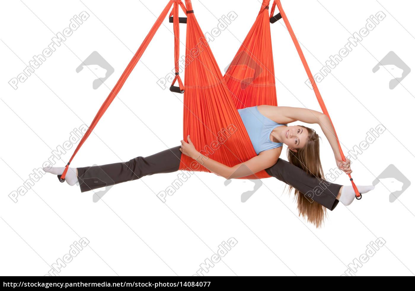 young, woman, making, antigravity, yoga, exercises - 14084077