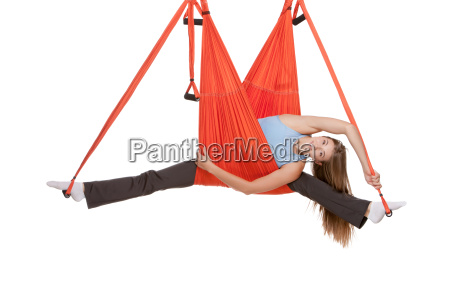 young, woman, making, antigravity, yoga, exercises - 14084077
