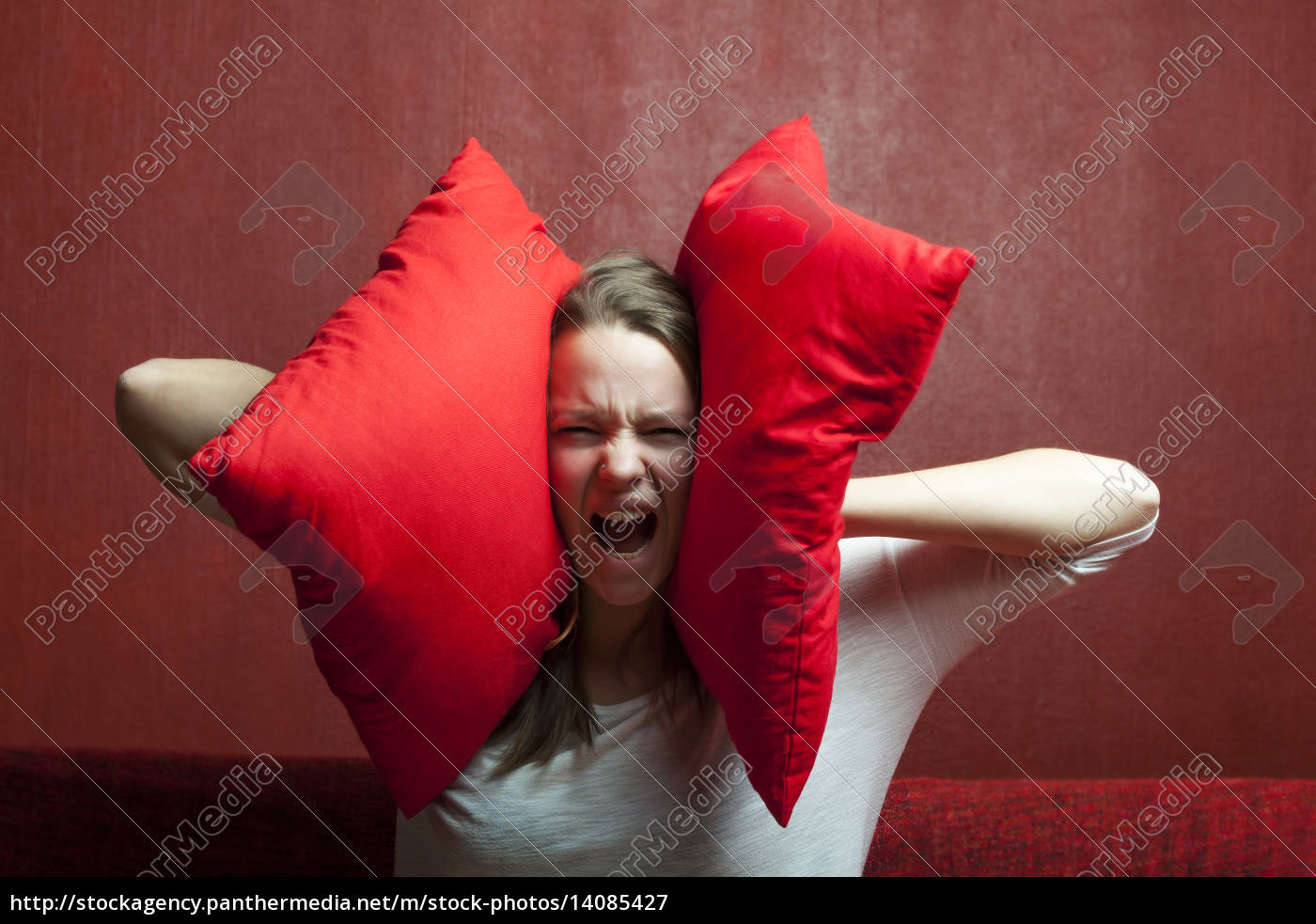 young, woman, with, pillow - 14085427
