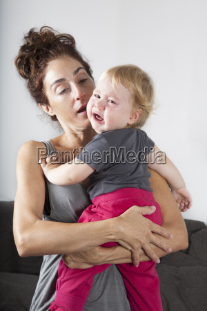 baby crying in mom arms