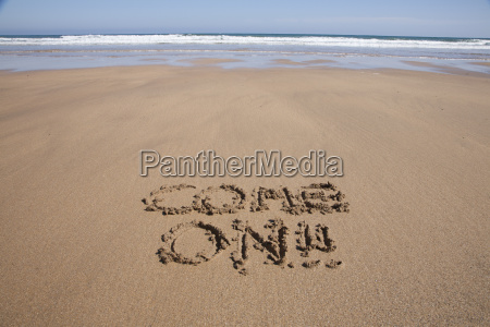 come on text in sand beach