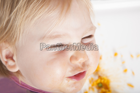 overhead smiling baby eating