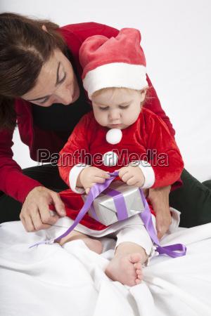 santa claus baby and mom opening