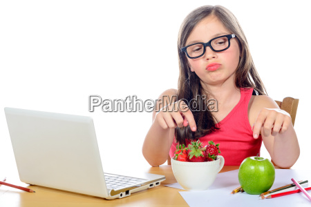 a, little, girl, at, her, desk - 14089377