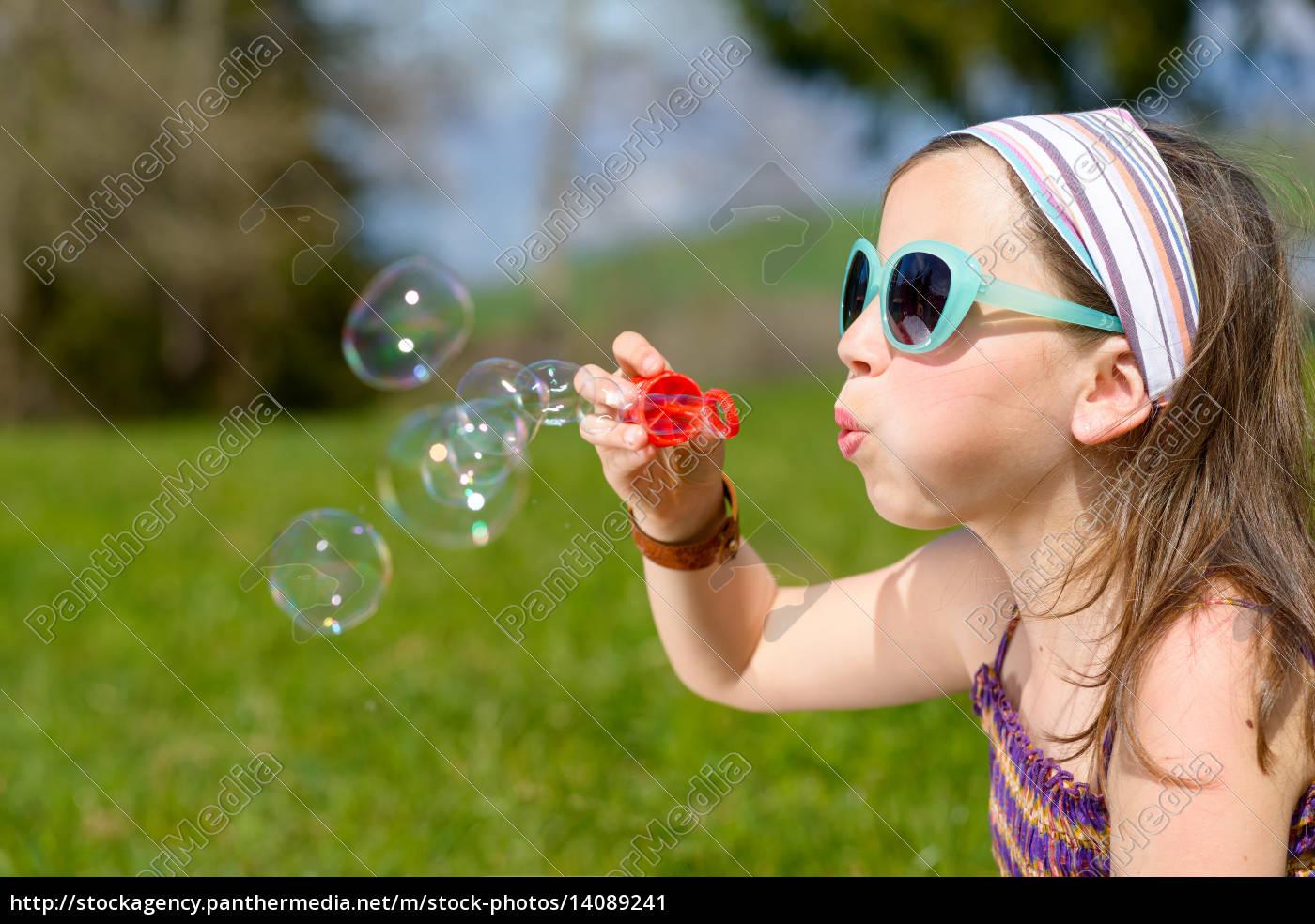 a, little, girl, making, soap, bubbles - 14089241