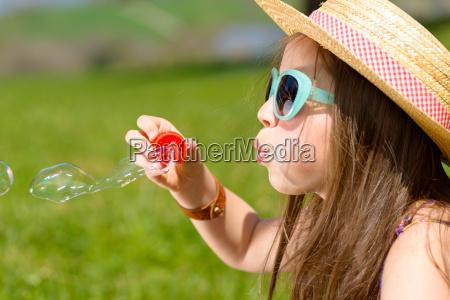 a, little, girl, making, soap, bubbles - 14089371
