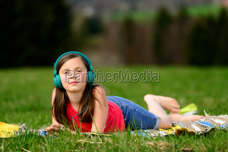 a, pretty, young, girl, listening, to - 14089237
