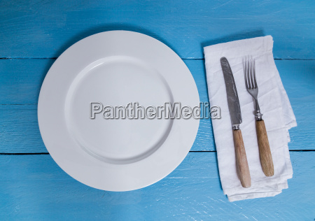 cutlery, and, plate, on, blue, wooden - 14089763