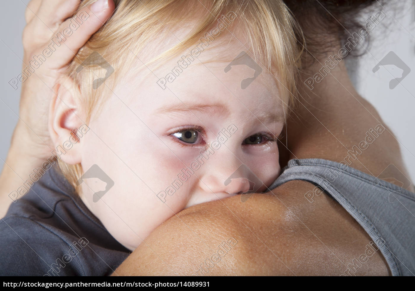 tears, in, baby, eyes, embraced, mother - 14089931