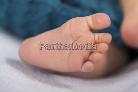 newborn baby wrapped in a blue