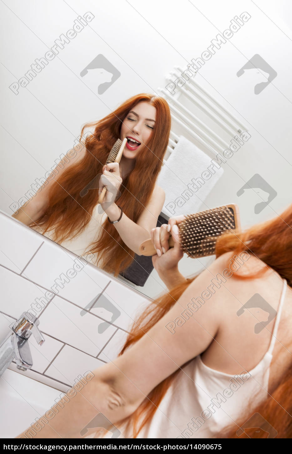 young, woman, with, red, hair, brush - 14090675
